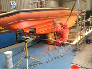 Hull filled, faired and first gelcoat layer being keyed back