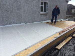 Fibreglass roof to Extension, measuring out the glass,